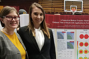 Students pose in front of presentation at Celebrate Gannon