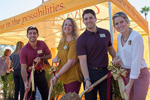 Students Pose with Shovels at Groundbreaking